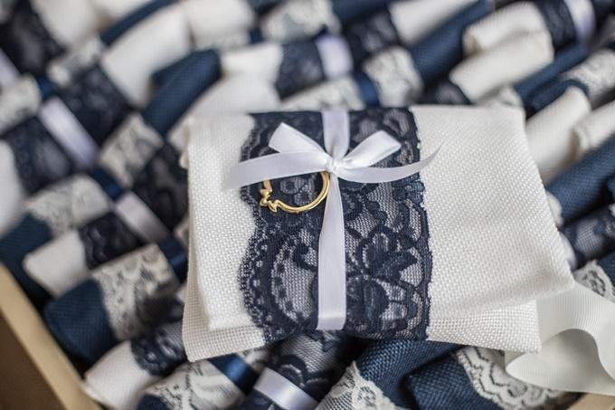 Envelopes guest favors with blue lace