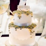 White wedding cake with gold and silver details
