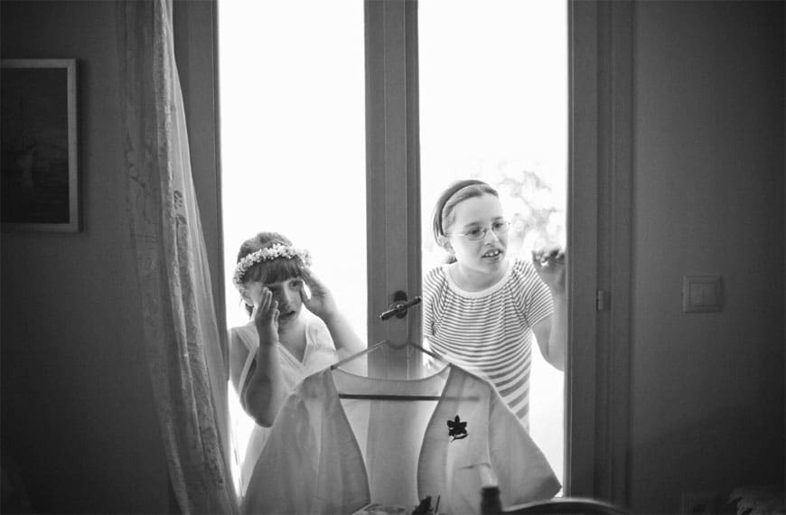 Flower girls watching the bride getting ready
