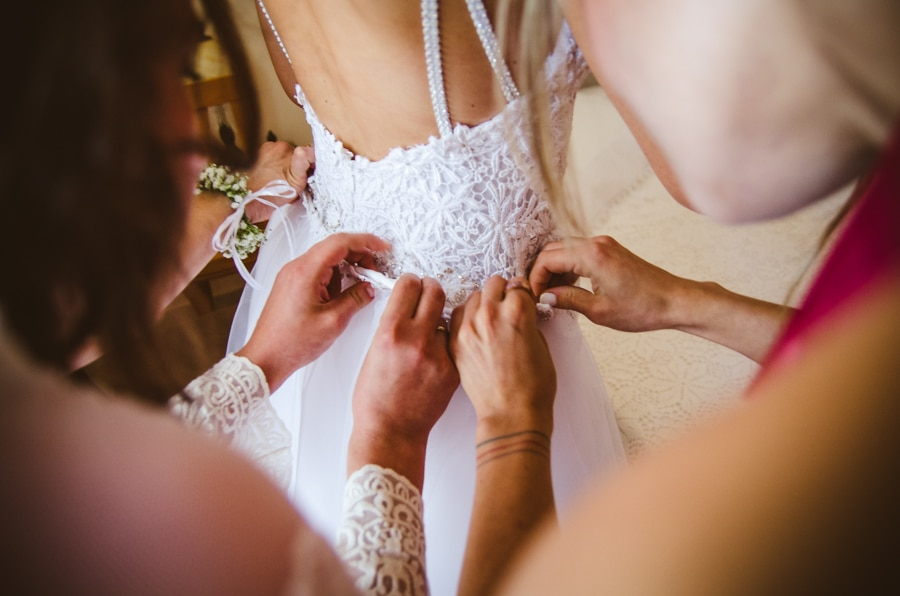 Bride's preparation with lace wedding dress