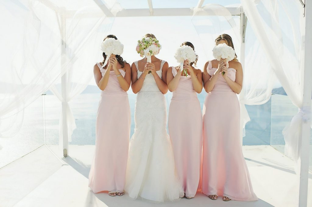 bride with maid of honor and bridesmaids flower bouquets