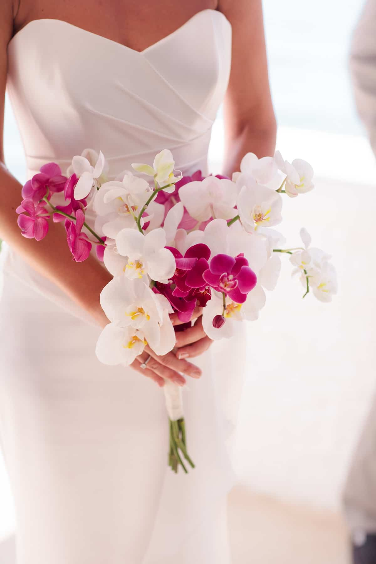 wedding bouquet with pink and white orchids