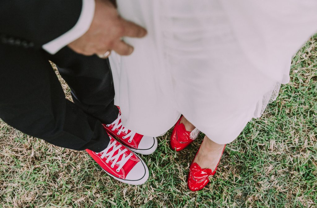 bride and groom with red shoes