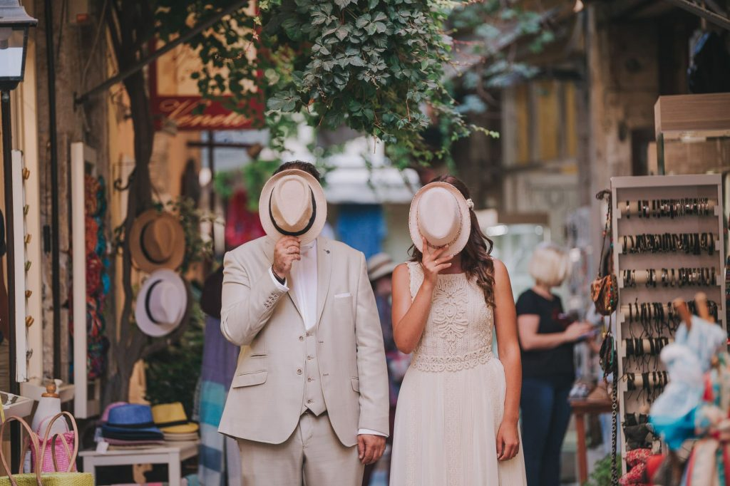 bride and groom with hats