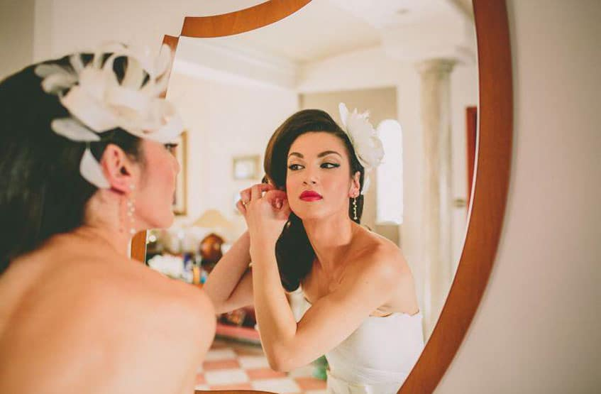 bride with vague hair do and red lipstick