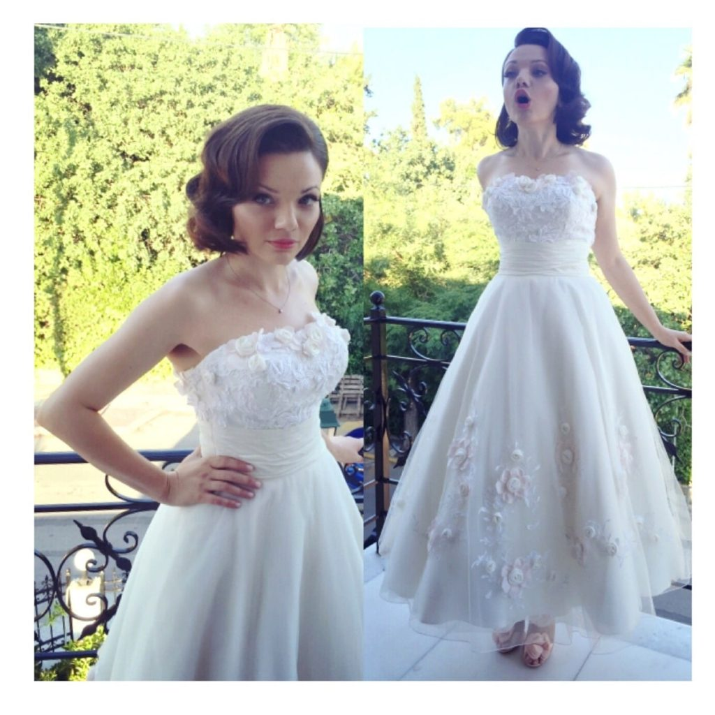 bride with vintage style hair do and bridal make up