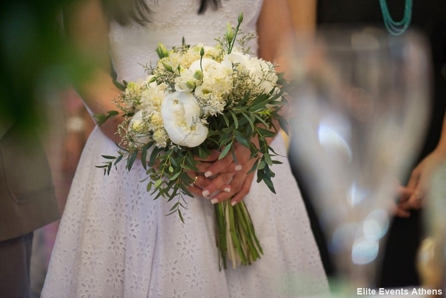 bride with white bridal bouquet