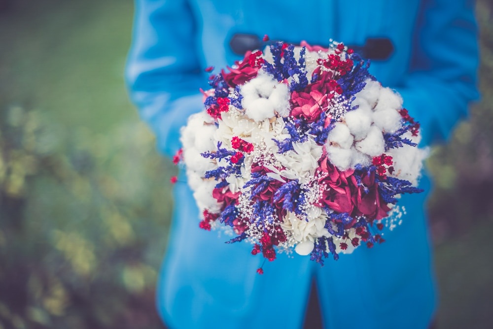 Groom holding wedding bouquet