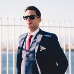 Groom in suit in beach wedding