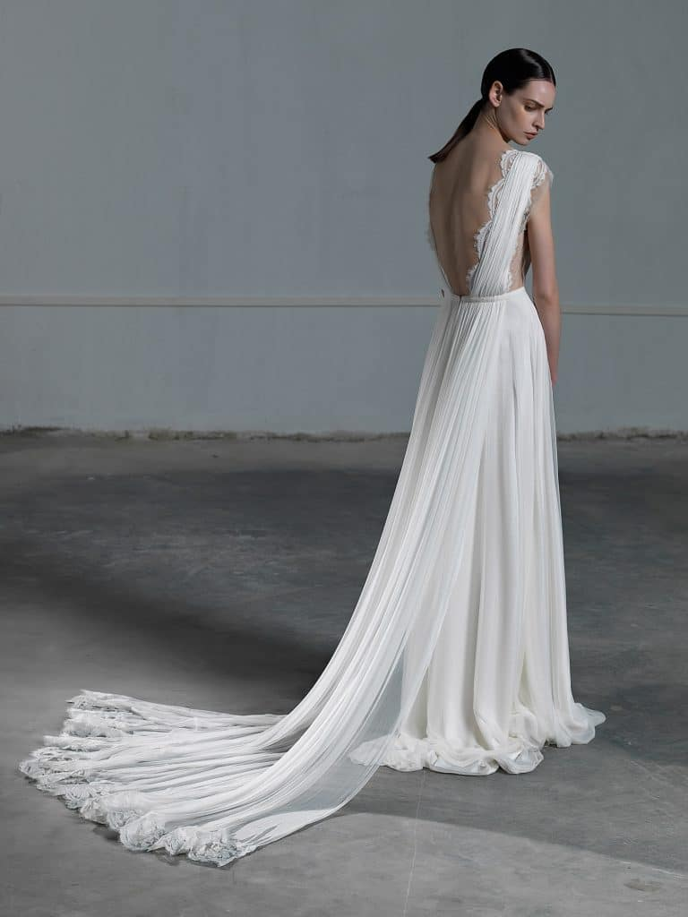 Romantic A line wedding dress with ethereal tulle skirt and lace top with low open back Vasia Tzotzopoulou