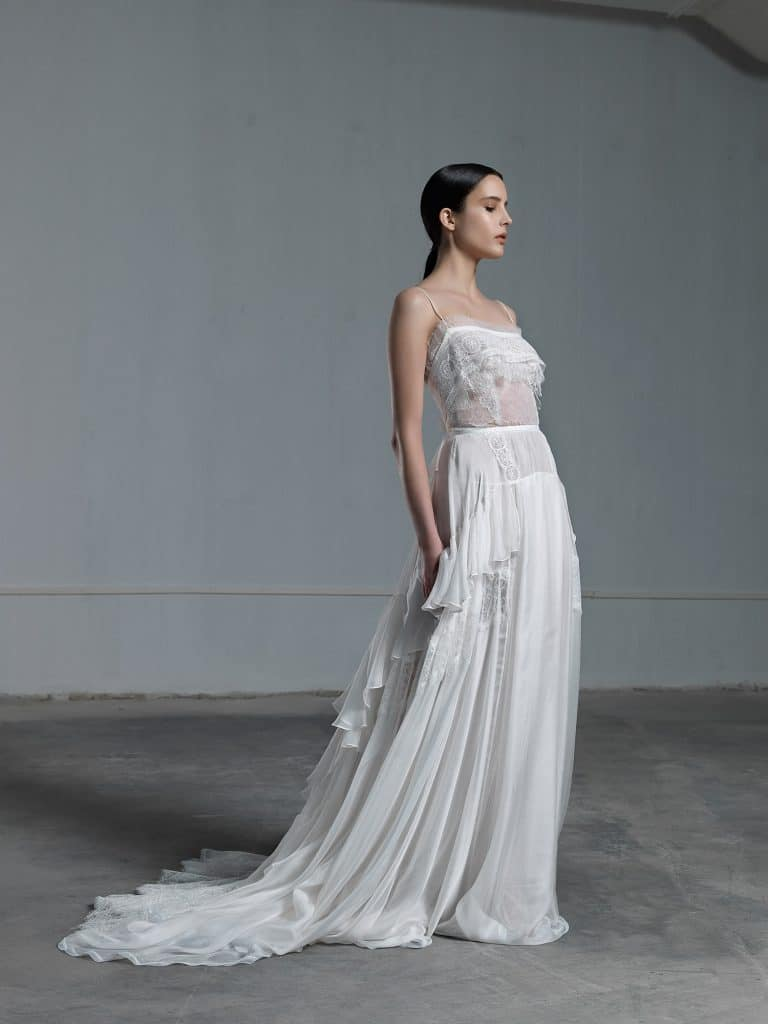 Romantic ethereal wedding dress with lace top with transparencies and skinny straps with skirt with frills Vassia Tzotzopoulou 2017