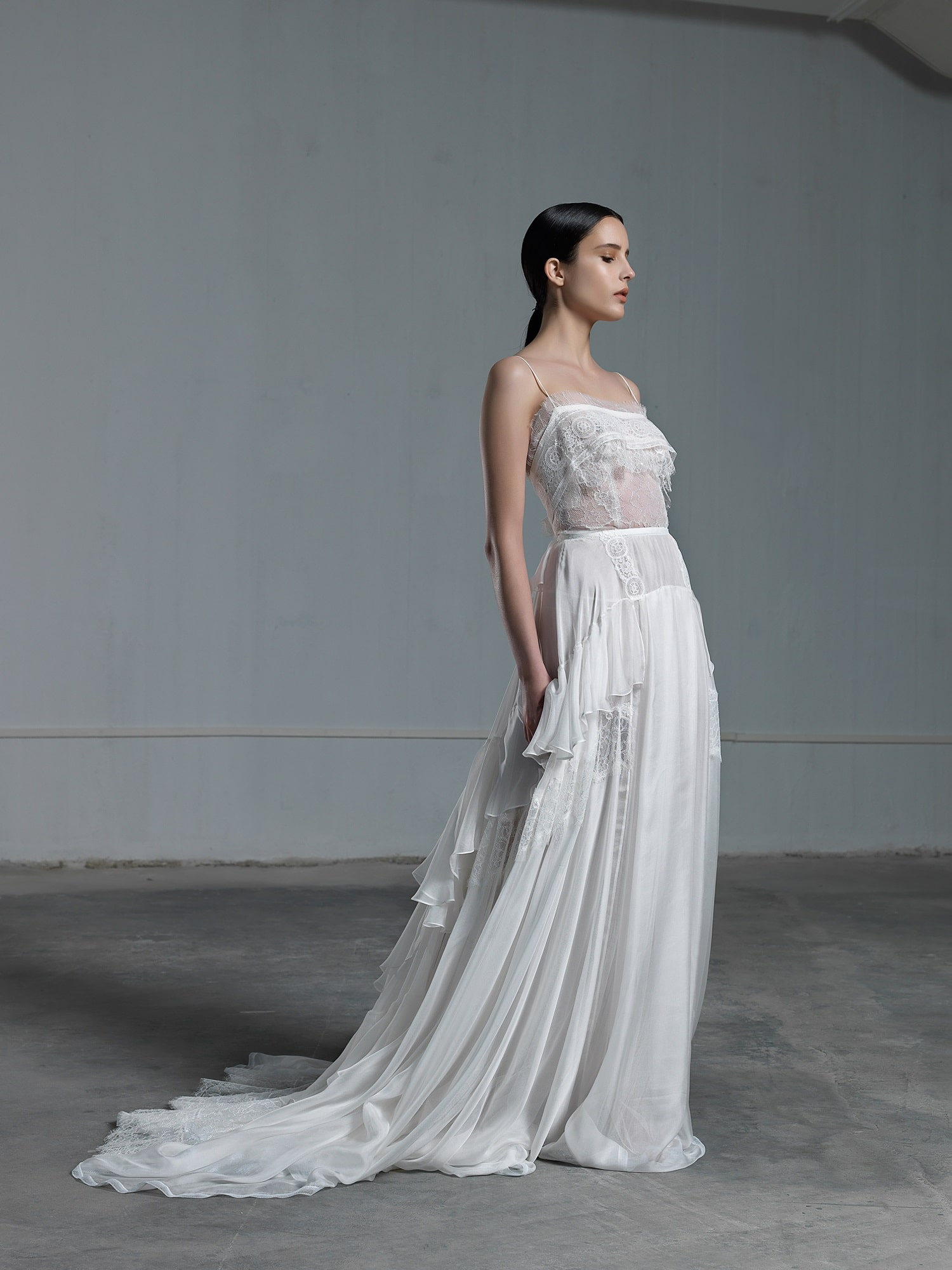 Romantic ethereal wedding dress vasia tzotzopoulou the wedding tales romantic ethereal wedding dress with lace top with transparencies and skinny straps with skirt with frills junglespirit Gallery