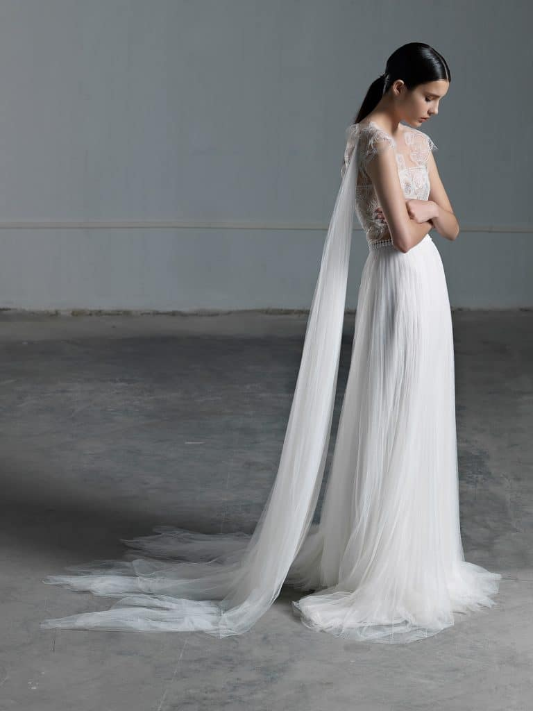 Impressive romantic A line wedding dress with illusion lace bustier and tulle cape