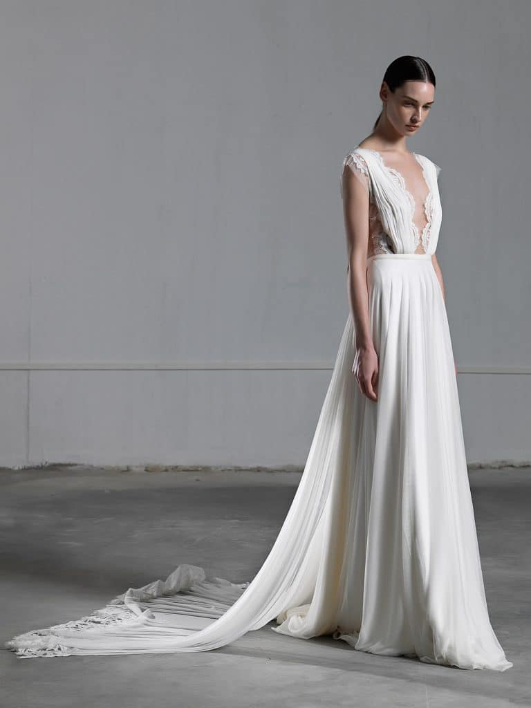 Romantic A line wedding dress with ethereal tulle skirt and lace top with low neckline
