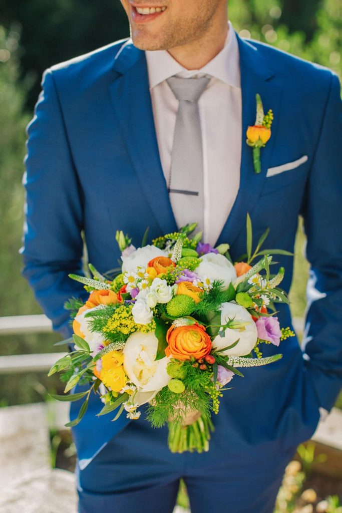 groom with a bridal bouquet