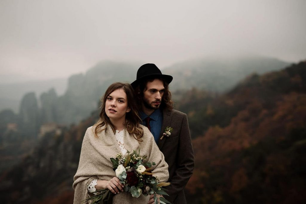 winter bride and groom in mountain wedding