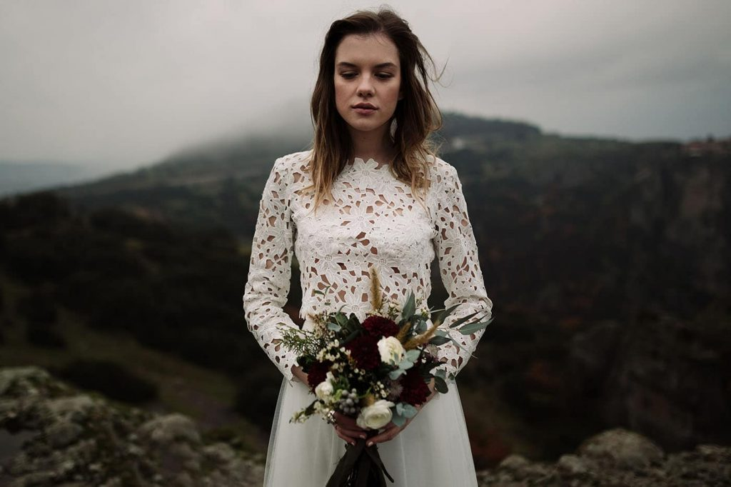 bride with winter dress and wedding bouquet