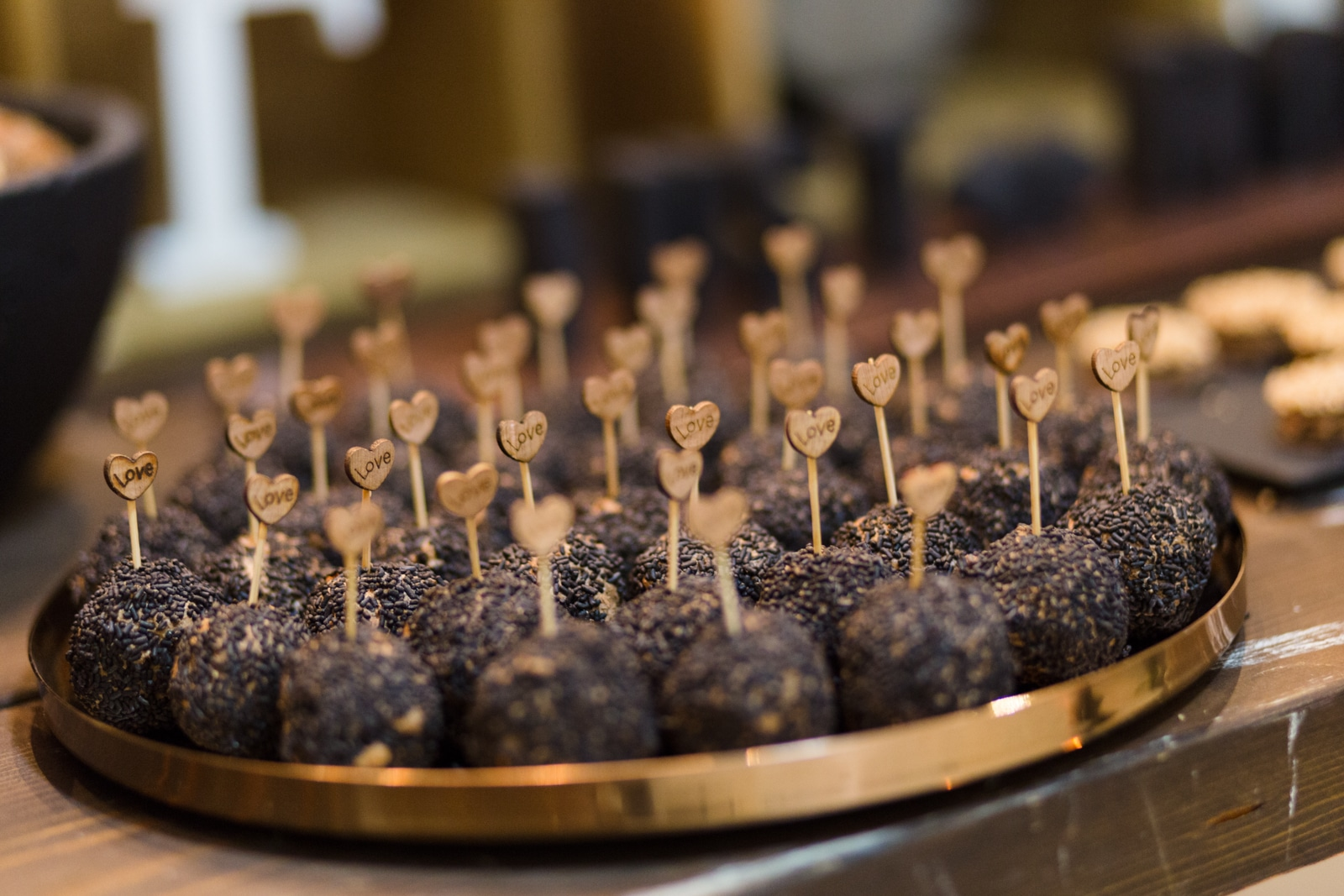 Black-gold rustic wedding decoration with chocolate desserts