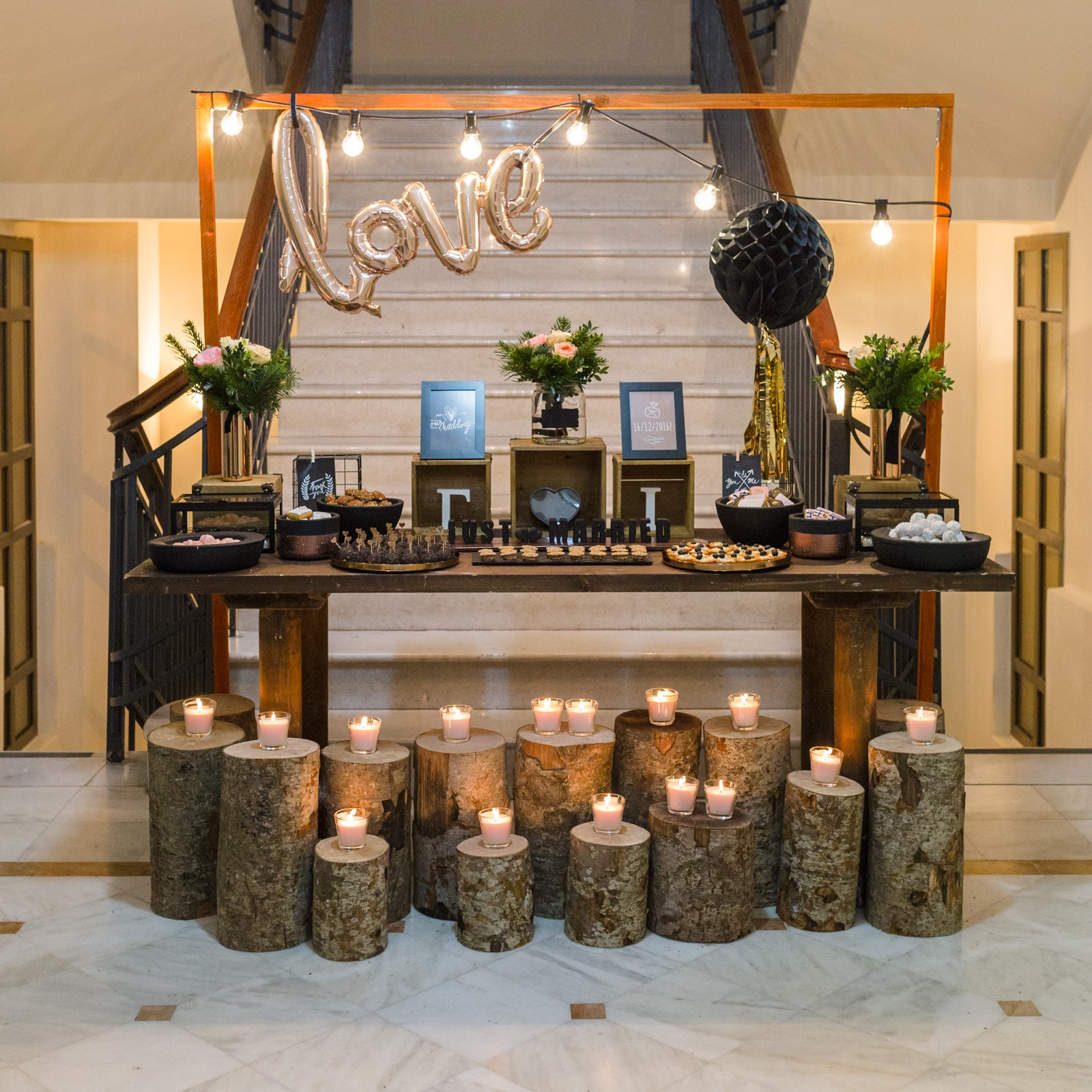 Rustic wish table with wooden logs