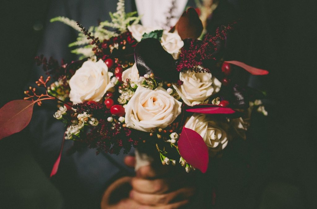 Bridal bouquet with white roses and red details