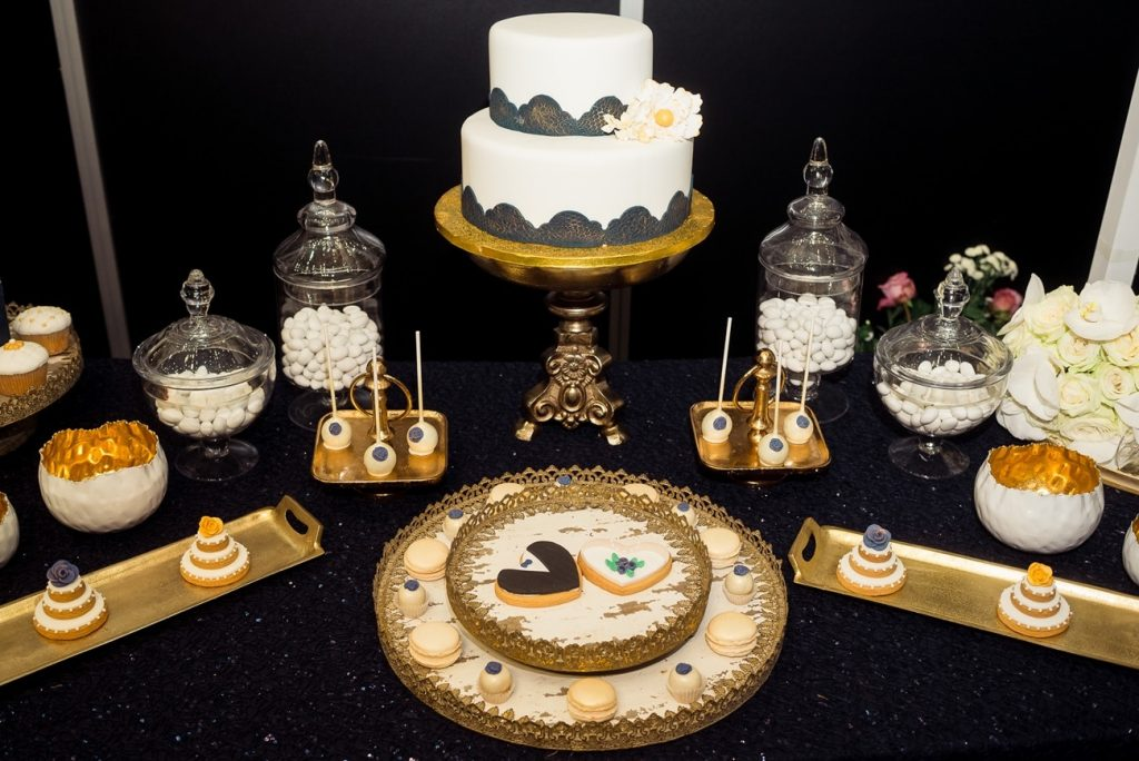 Wedding wish table with wedding cake with lace decoration and mini wedding cake and bride and groom cookies