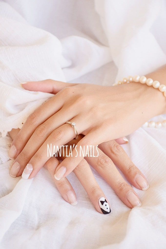 White bridal manicure with bowtie design
