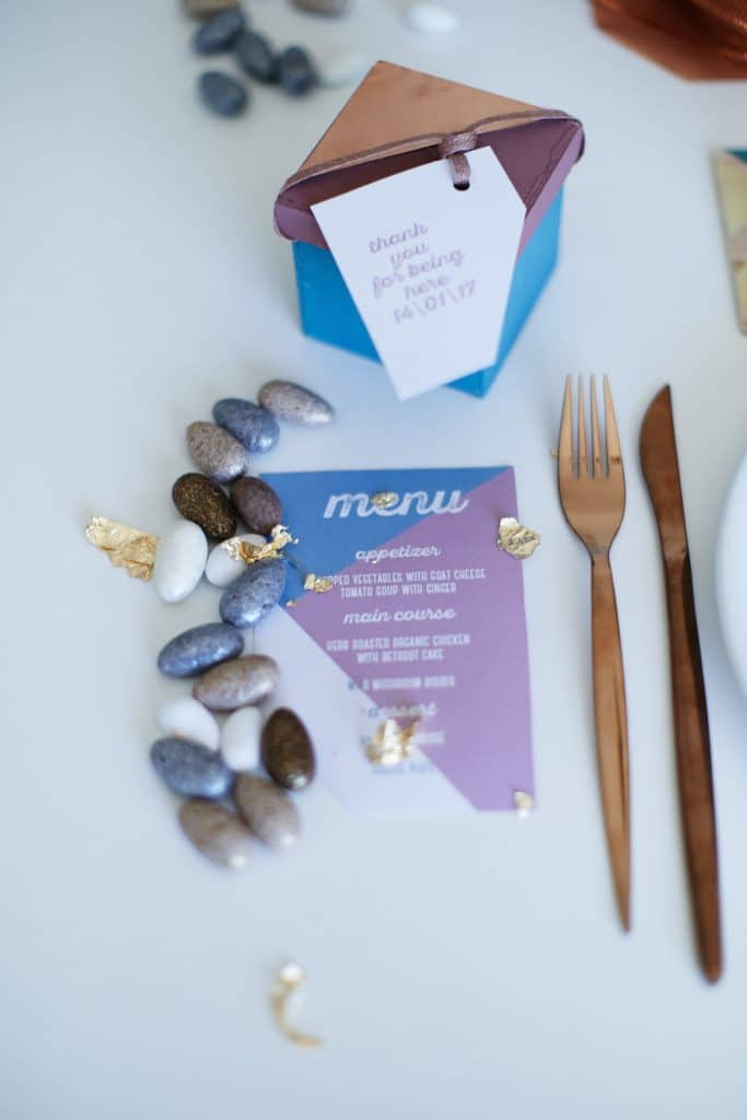 Modern geometrical wedding table decoration with box guest favor and menu in pal blue and lilac colors