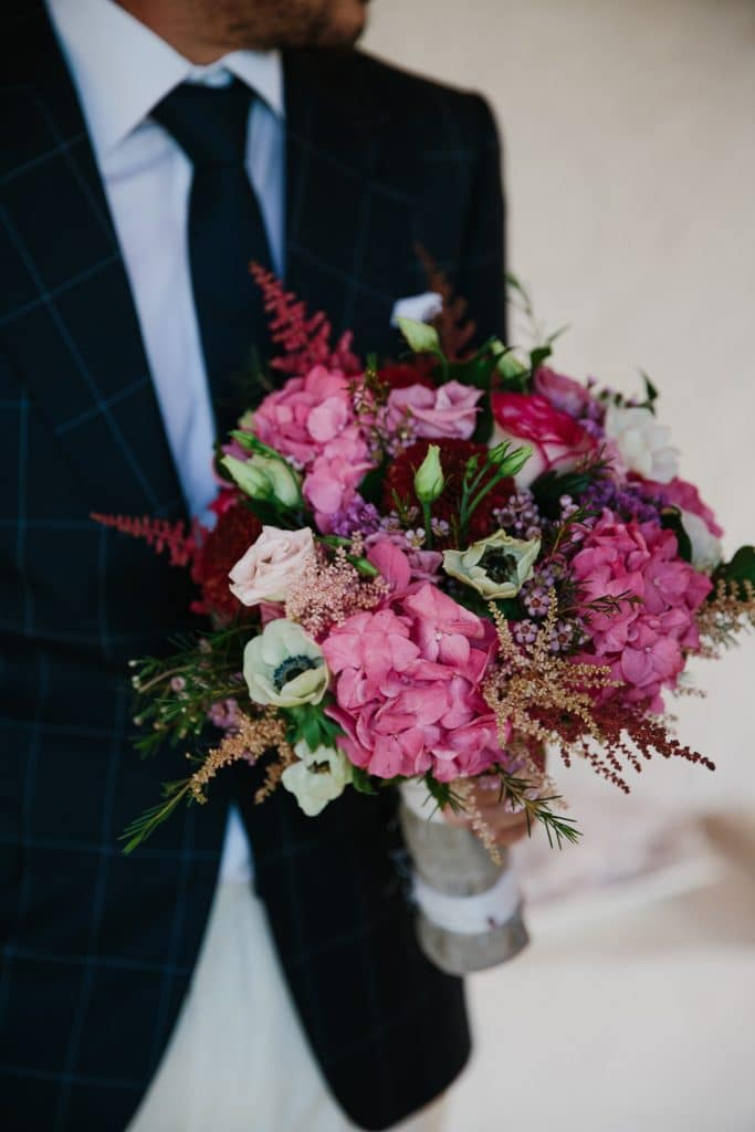 Colorful bridal bouquet with anemones and pink hydrangenas