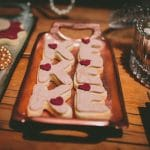 Pink wedding biscuits with the couple's monogram