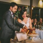 Tradition of cake cutting by the bride and groom
