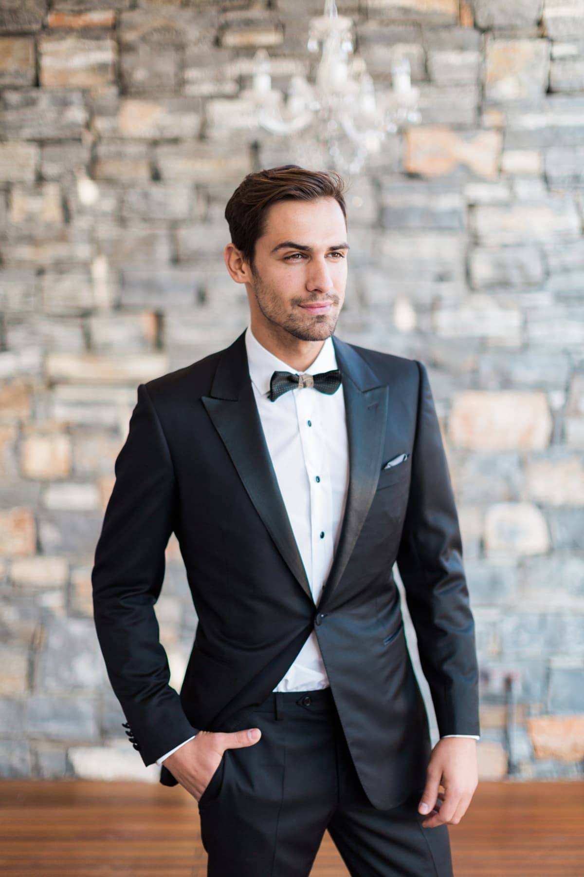 Black groom\'s suit with black bow tie Giannetos   The Wedding Tales