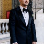 Groom's black suit and black bow tie Tom Ford