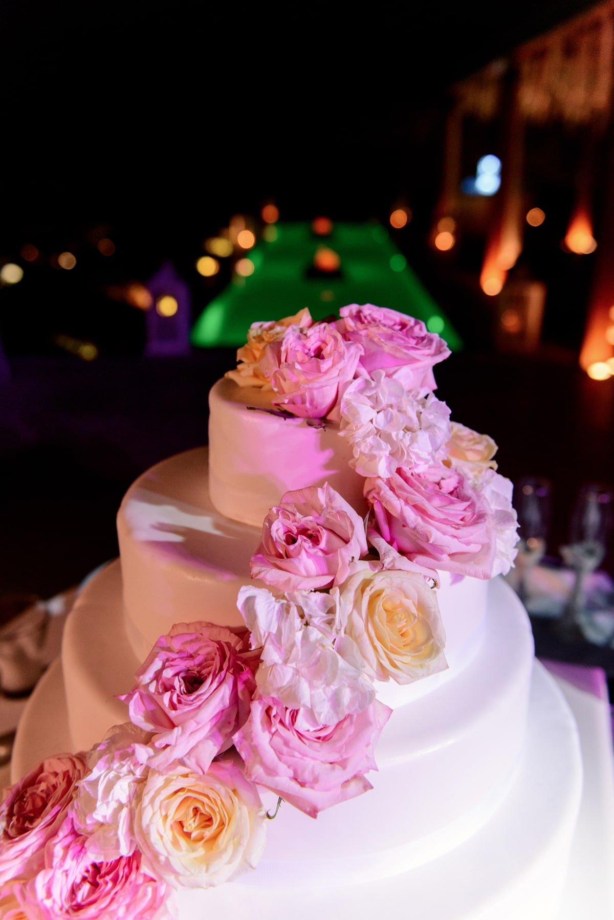 White wedding cake with pink & peach roses Aria Fine Catering | The ...