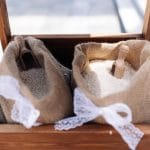 Wedding rice in burlap sacks