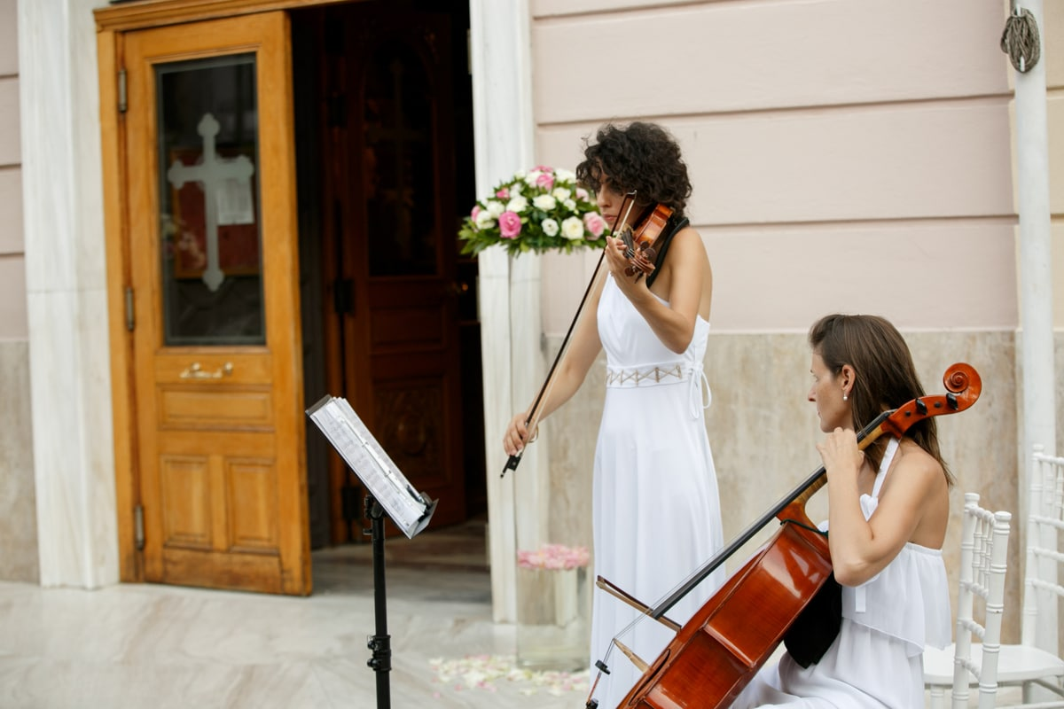 Music with violins outside the church