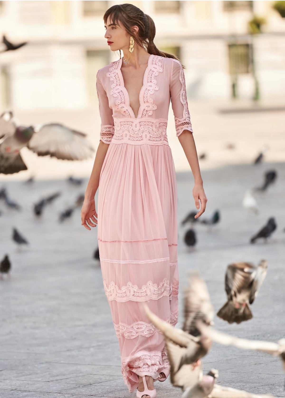 Long pink dress with deep neckline with 3/4 sleeves Christos Costarellos
