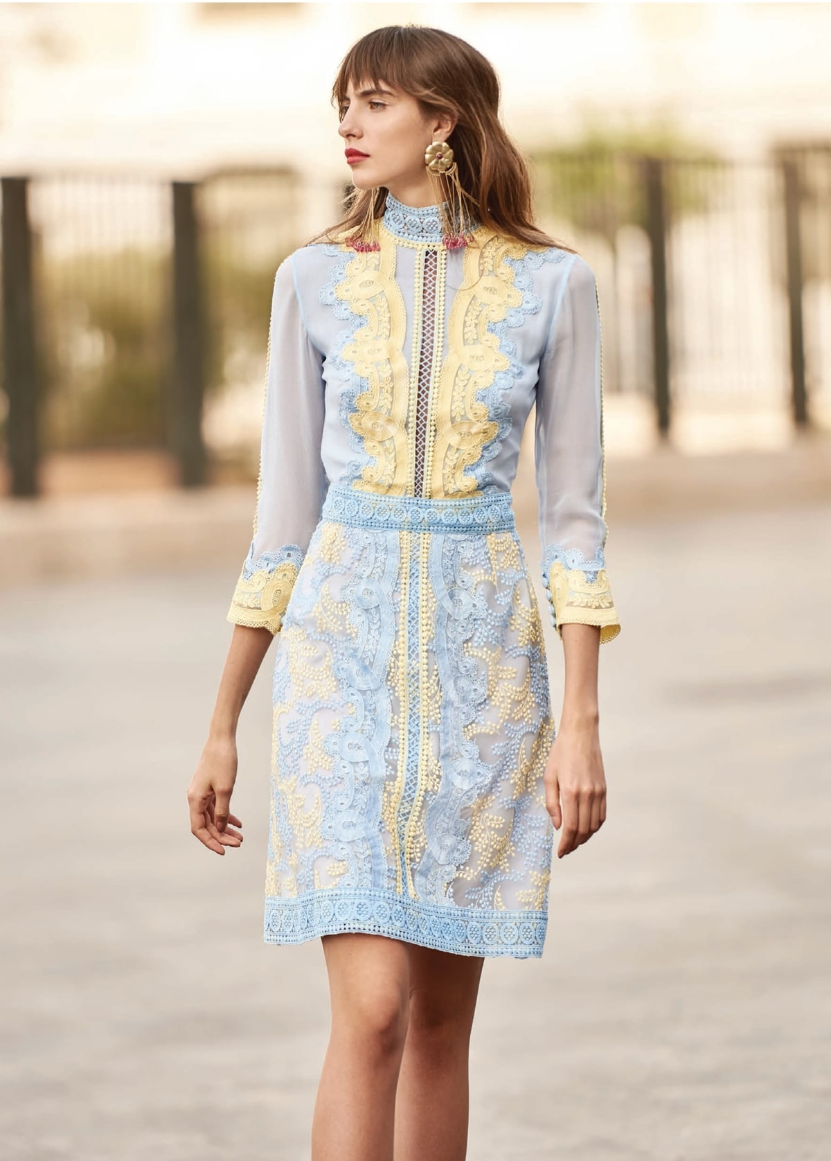 Short baby blue dress with yellow laced details Christos Costarellos