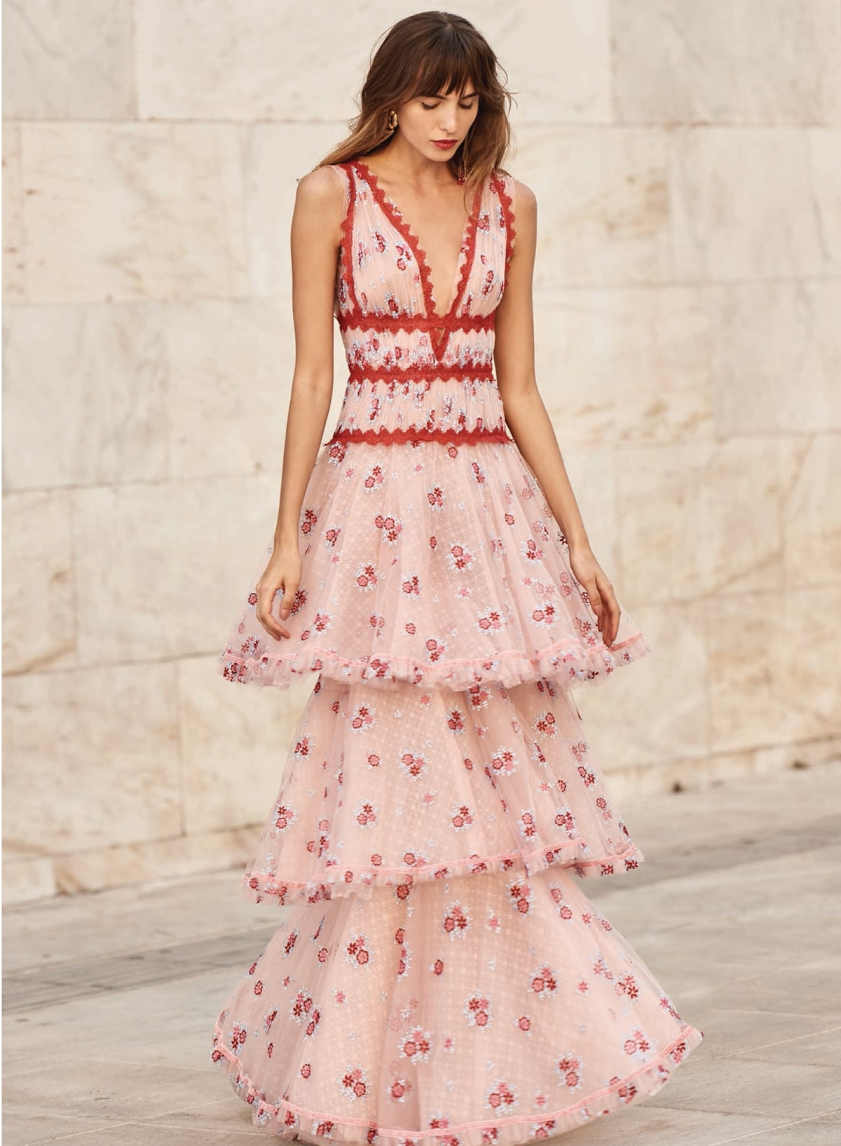 Long ruffled peach dress with red laced details Christos Costarellos