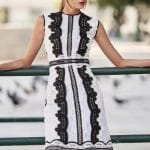 Short white sleeveless dress with black laced details Christos Costarellos