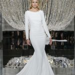 Mermaid sleek white wedding dress with long sleeves and boat neckline Pronovias