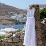 White straight line wedding dress with crochet lace