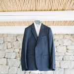 Blue suit for the groom with white shirt