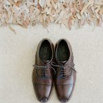 Brown laced groom's shoes