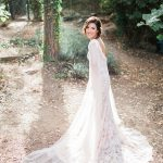 Trumpet laced wedding dress with long sleeves and open back
