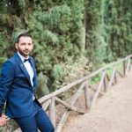 Blue suit for the groom with a bowtie