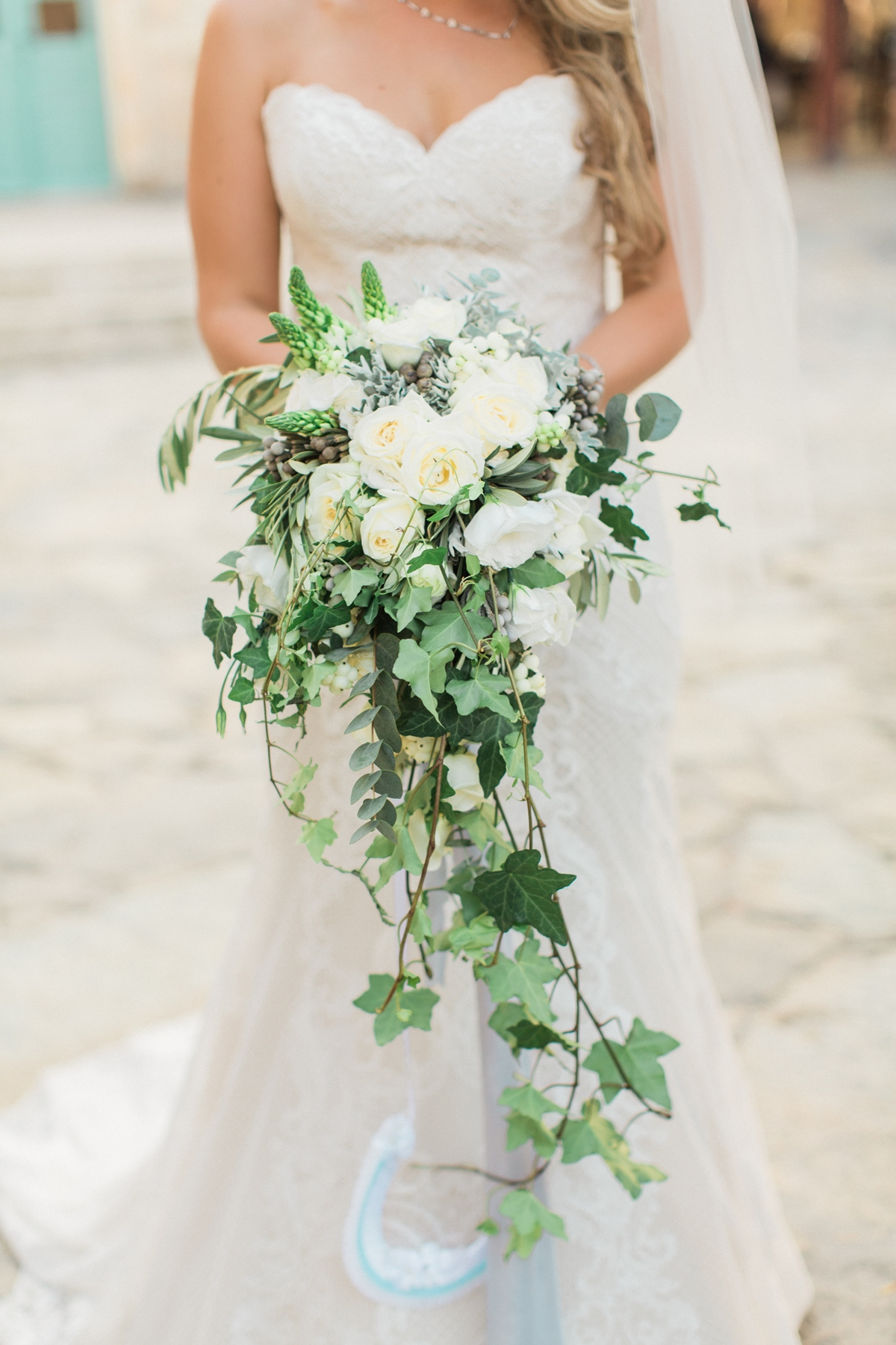 Bridal bouquet with white roses, olive leaves and ivy