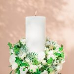 Wedding candles with white roses, olive leaves and ivy