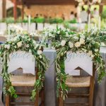 Bride and Groom's chairs with garland of white roses, olive leaves and ivy