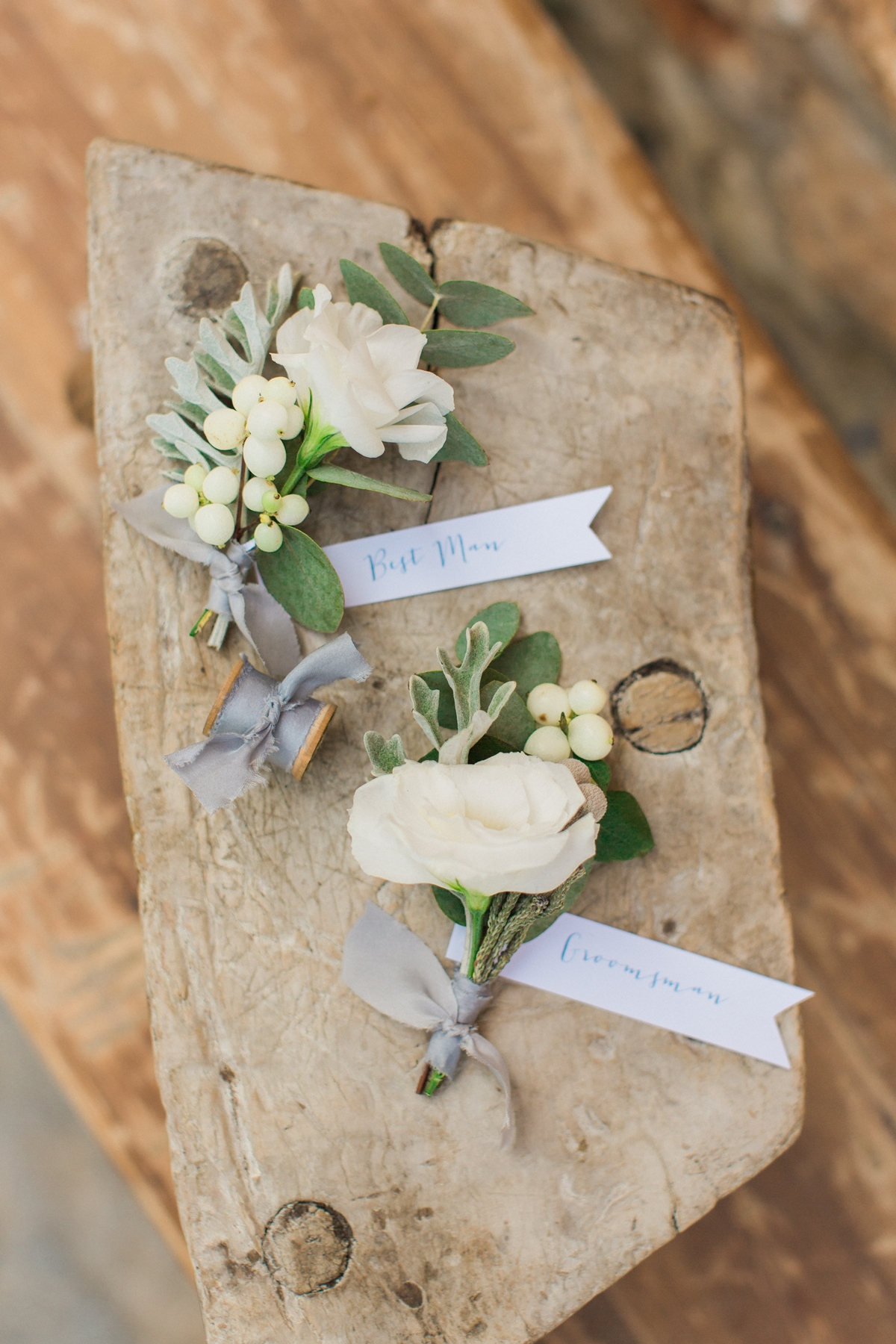 Groom and best man's boutonniere with roses and olive leaves