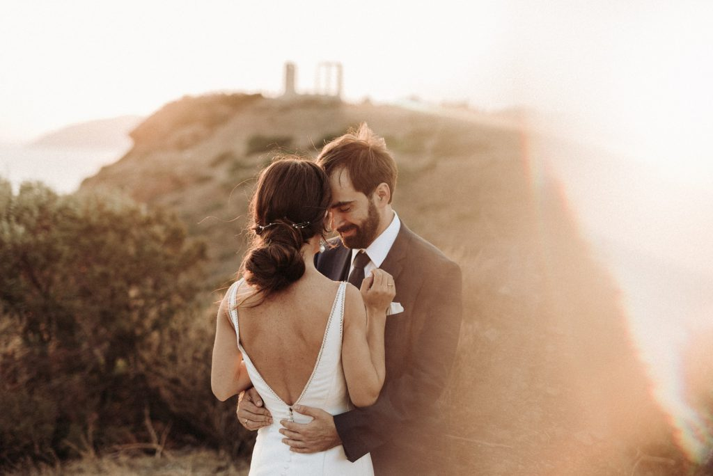 Intimate wedding with rustic touches and olive brunces